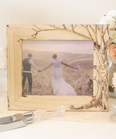Take a look at this Tan Love Tree Initial Frame on zulily today! Elegantly crafted from natural pine, this precious piece is uniquely engraved for a personal touch and transforms a favorite photo into a cherished keepsake.