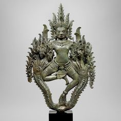 Divinity with Nagas. Cambodia, Khmer, 13th century, Bayon style. Copper alloy. Courtesy of #AsiaWeekNY 2016 dealer Carlton Rochell Asian Art.
