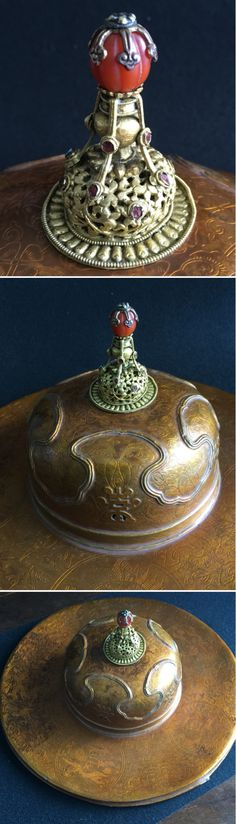 Official hat, gold lacquered papier-mache, open-worked gilt metal top with red agate terminal. Tibetan 19th c Private collection