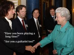 """Speaking to musician Eric Clapton, second left, at a Buckingham Palace reception for the British music industry in March 2005, the Queen asked: """"Have you been playing a long time?"""" She later asked Led Zeppelin's Jimmy Page, centre, """"Are you a guitarist too?"""" Picture: AP"""