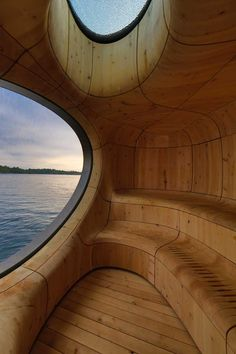 Wooden Curved Grotto Sauna by PARTISANS
