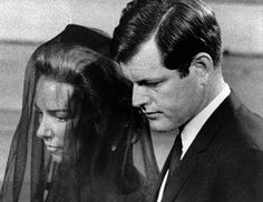 The last remaining Kennedy brother Teddy escorts his pregnant sister-in-law as they attend her husband Robert F. Kennedy's Funeral at St. Patrick's Cathedral, New York ~ June 1968