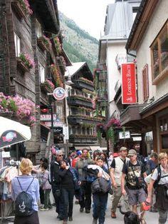 Zermatt, Switzerland shops with Matterhorn behind.  Saw kinder on way to school.