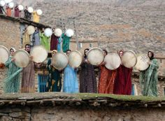 a wedding in a small town in Iran. ladies standing on top of the roofs of their houses, and playing daf. a Persian musical instrument. Women In Iran, Iranian Women, We Are The World, People Of The World, Frame Drum, Visit Iran, Religion, Shoot The Moon, Persian Culture