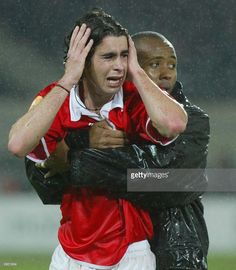 Benfica Tiago (L) and Guimaraes Guga (R) comfort eachother after Benfica's Hungarian soccer striker Miklos Feher (down) during the Portuguese Premier League match held at Guimaraes stadium 25 January 2004. Hungarian striker Mikos Feher became the second international footballer in the last seven months to die during a game when he collapsed after being yellow-carded while playing for Benfica. The 24-year-old Feher, who had come on as a substitute after 60 minutes, was rushed to hospital but…