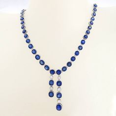 Edwardian Blue Sapphire Diamond Negligee Necklace. An Edwardian platinum necklace with blue sapphires and diamonds. The négligée necklace has 60 old European-cut blue sapphires with an approximate total weight of 40.00 carats, and 5 old European-cut diamonds with an approximate total weight of 1.00 carats. Circa 1900-20's.