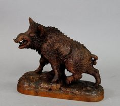 great black forest carved wood wild boar - in the manner of peter burri | From a unique collection of antique and modern sculptures at https://www.1stdibs.com/furniture/decorative-objects/sculptures/