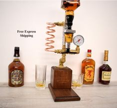Whiskey Dispenser, Liquor, Gin, Wine, Alcohol mini Bar. Handmade alcohol dispenser ----------------------------------------- This dispenser has been designed for ease use with the simple twist of a valve. Neat and elegant way of dispensing alcohol that prevents wastage or spillages. Makes it simple Whiskey Dispenser, Alcohol Dispenser, Copper Art, Copper Pipes, Garden Bar, Bourbon, Gin, Make It Simple, Liquor