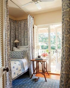"""1,565 Likes, 13 Comments - Veranda Magazine (@verandamag) on Instagram: """"A blue-and-white palette unifies a bedroom layered with patterns. Vintage iron bed; bed hanging in…"""""""