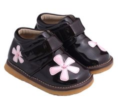 These lovely patent chocolate flower boots feature a velcro side closure for a secure, adjustable fit and stitched flower embellishments for that perfect girly look.