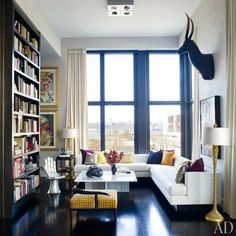 Jamie Drakes New York City Apartment : Architectural Digest. I love this shiny black floor. Maybe something like that for our bathroom? (Not wood, probably.)
