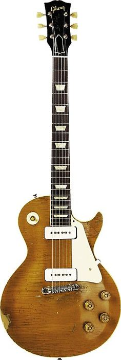 1956 Gibson Les Paul Goldtop with wraparound tailpiece.  http://www.vintageandrare.com/search/search_txt/gibson%20les%20paul%20gold