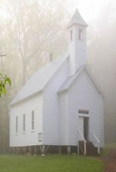 Old white church in the country on a misty morning ... #church
