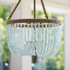 Cut seaglass beads form a dramatic canopy beneath a hemp-wrapped steel frame