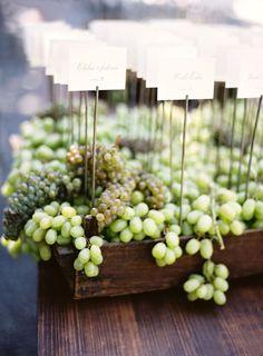Napa-inspired grape escort cards: http://www.stylemepretty.com/2015/11/16/fall-beaulieu-gardens-wedding/ | Photography: Jose Villa - http://josevilla.com/: