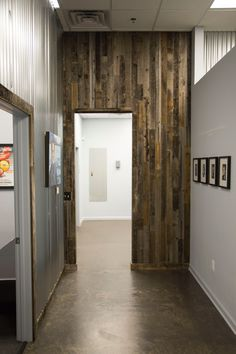 Chiropractic History Hallway: We used inexpensive corrugated metal to finish the wall on the left and left-over aged fence wood over the entry way. The wood boards were cut to size and placed vertically over sheetrock to go along with our Vertical Theme. Inexpensive Home Decor, Cheap Home Decor, Chiropractic Office Design, Chiropractic Therapy, Massage Therapy Rooms, Office Paint Colors, Winery Tasting Room, Future Office, Clinic Design