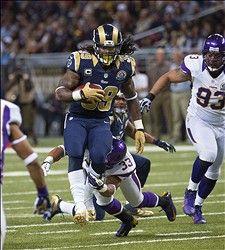 running back Steven Jackson breaks away from Minnesota Vikings strong safety Jamarca Sanford. Jackson passed the 10000 career rushing yard mark on the play.  :)  12-16-12