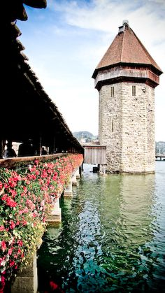 Lucern, Switzerland is where you can find one of the oldest wooden bridges in all of Europe, the Chapel Bridge.  Built in 1333 this wooden bridge stretches across the Reuss river, and inside it has various paintings depicting scenes from Swiss history.  It was quite lovely!