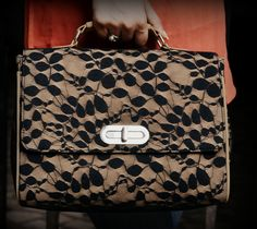 dziine bags are awsome.this neta nd pu mix briefcase style bag rocks...just love it. available at www.designemporia.in