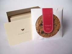 Package your cookie favors in CD sleeves. 100 sleeves for around 5 bucks :)