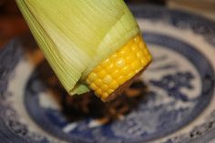 Try: Put corn in microwave. Don't shuck. 4 min per ear. Cut off end at cob, hold by tassels and the corn slides out. NO silks!