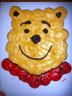 It is all cupcakes and I used Wiltons frosting colors to mix the colors for Pooh bears face.  I placed the cupcakes and simply frosted over them as if they were a cake.  He was so excited!