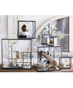 <p>Exhibit your prized possessions in understated elegance by housing them in these fabulous glass boxes from Roost. Each box features...