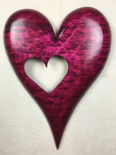 Red personalized wooden wall heart shaped by TreeWizWoodCarvings