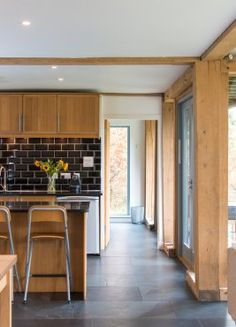 A mixture of clean, contemporary materials and exposed heavy oak structural frame.By Roderick James Architects.