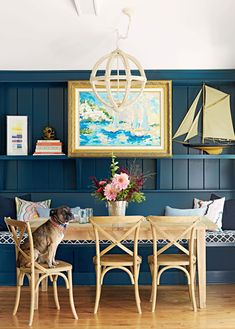 Artist Kristi Kohut blurs the boundaries between land and water, work and home at her family's colorful and airy lake retreat in Wisconsin. See more at our story. Mirror Painting, Painting Cabinets, Painting Frames, Reading Loft, Brass Sconce, Summer Decorating, Nautical Looks, Black Floor, Weathered Oak