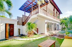 Bali vacation rental // white and wood home with pool