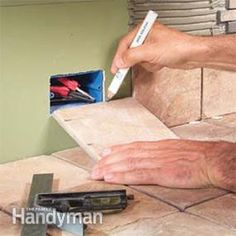 Complete how-to for laying a tile countertop and backsplash, from preparing the surface to cutting and placing the tile in mortar, grouting, sealing and maintenance.