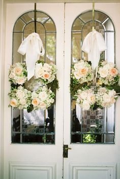 Double wreaths. This would look good on the church doors for a wedding or for the wedding shower.