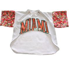 """D.Fame Floral """"Miami Hurricanes"""" Cropped Crewneck ($65) ❤ liked on Polyvore featuring tops, shirts, crop tops, crop, flower print shirt, crew-neck shirts, henley shirt, floral shirt and crop shirts"""