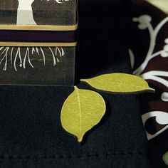 Use these willow leaf shaped wooden leaves as a decorative table scatter or novel tags for favors or place markers. Combine sizes and shapes for added visual appeal. Available for purchase online at http://madelinesweddings.weddingstar.com/product/willow-shaped-wooden-die-cut-leaves-in-woods-green