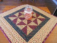 Country Colors Quilted Table Topper/Wall Quilt pinwheel pattern with burgundy, beige and green fabric by RubysQuiltShop on Etsy