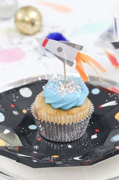 "Space Party Cupcakes - Looking to throw a Space or Rocket themed birthday? Check out this game-changing ""party in a box"" recommendation as well as tips for personalizing the party! Get details now at fernandmaple.com."