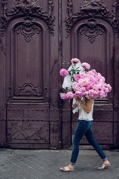 This is such a pretty photo! We love the bright flowers and the purple door! How chic?!!