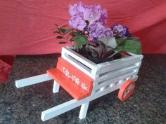 Colorful Pallet Wheelbarrow Planters | 101 Pallets