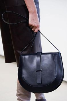 JILL SANDER: This minimalist bag on the runway at Jil Sander is a statement piece that will stand the test of time.