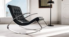 KEL - Rocking chair with special processing quilted leather or fabric not removable, characterized by the curved line of the seat and the structure consisting of a metal blade chrome.