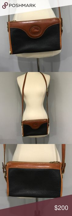 "Vintage Leather Navy & Tan Dooney & Bourke purse. Vintage Leather Navy & Tan Dooney & Bourke Cross body purse. Beautiful vintage leather bag in great condition. Bag measures 9.5"" L x 6"" H x 2.5"" W. From clean smoke free home. Sorry, no trades. *Bundle two or more items from my closet and get 10% off.* Dooney & Bourke Bags Crossbody Bags"