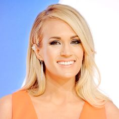 Before her hosting duties got underway, Carrie Underwood hit the red carpet at the 49th Annual CMA Awards, modeling a sultry smoky eye that added drama to her coral confection of a dress. Find out which products made the look at Usmagazine.com!
