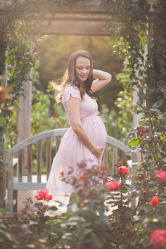 Maternity photo is rose garden by best Northern Virginia maternity photographer Rachel K Photo.