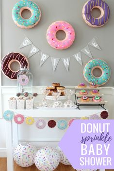 """Throw your own donut-themed sprinkle for a mom-to-be like @weheartparties did! A """"sprinkle"""" is a low-key baby shower thrown for a mom who is celebrating baby number 2, 3, 4, etc. We love this cute donut theme and all of the donut party decorations!"""