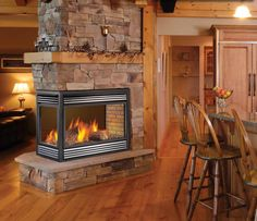"Wish mine looked like THIS. Rock ""chimney"" all the way to the ceiling plus a mantle on all three sides."