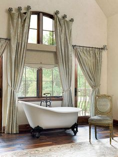 Taking its design cue from a slipper's form and comfort, footed slipper tubs boast one heightened, sloped end that supports a bather's back and promotes lounging. The curved shape of slipper tubs enhances elegant bathrooms. This tub's bronze ball-and-claw feet stand out while echoing the tub filler's finish.