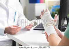injured patient showing doctor broken wrist and arm with bandage in hospital office or emergency room. sprain stress fracture or repetitive strain injury in hand. first aid. Carpal Tunnel Surgery Recovery, Long Term Disability Insurance, Repetitive Strain Injury, Burn Injury, Stress Fracture, Overcoming Addiction, Carpal Tunnel Syndrome, Withdrawal Symptoms, Sprain