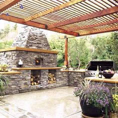 An 8 1/2-by-6-foot wood-fired pizza oven—with built-in storage, shelving and chimney—is king of this kitchen. But its workhorse is a 53-inch stainless steel gas grill with rotisserie, smoker box and storage.