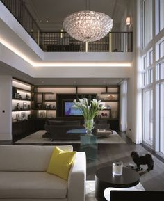 Living Space & Loft - Elegantly conceived with defused lighting and shelving with lit backs. Massive natural light with spacious open concept in a muted palette. Stunning!